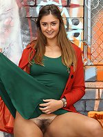 Adel wears a little green dress, orange winter coat and flashes us her girlie goodies. A nice furry pussy, perky breasts and a good strong arse has us all Ga-Ga a for this leggy brunette. She%u2019s a champ and a great girl to hang out with