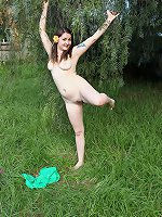 Tattooed natural Stellar lounging naked in garden